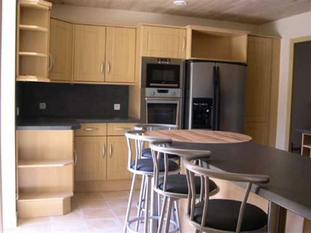 Beautiful fully equipped kitchen with door leading to patio area