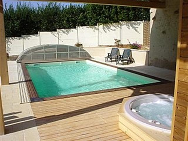 lovely swimming pool, suana and hot tub/Spa at Moulin de Garreau