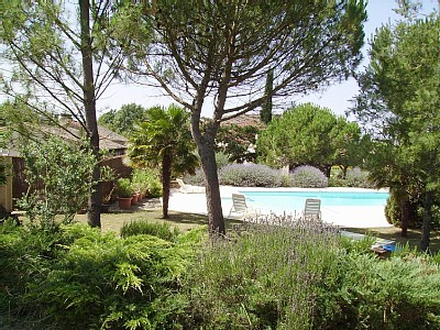 swimming pool and baeutiful landscaped gardens at Baronnerie self catering holiday home in Charente